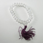 Stretch mala bracelet with purple tassle