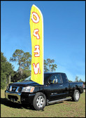 Tire base for swooper/feather flag pole shown in use, does bnot include banner, pole or truck....