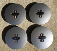 This is a set of 4 Pony R Parts, Pony R Wheel caps.  The finish is argent.  They will fit  Pony R wheels, and OEM Mustang pony wheels.  Excellent fit and finish!
