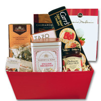 Gift basket arrangement filled with teas, dessert wafers, confection caramels, dried fruit, and honey
