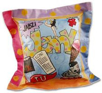 Hand painted graduation pillow with first name, motarboard, diploma, graduation year, college name, and hobbies