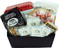 Gift basket arrangement filled with custom cookies, snacks, nuts, chocolates and caramels