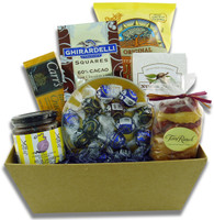 Gift basket arrangement filled with chocolates, crackers, and dips