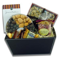 Gift basket arrangement filled with sweet and salty edibles, caramels, chocolate covered fruit, cookies, and nuts