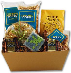 Gift basket arrangement filled with sweet and salty snacks with a portion of the proceeds going to hunger relief