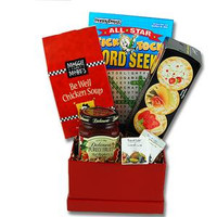 Personalized get well soon gift basket filled with novelty note paper and pen, tea, honey sticks, and lemon drops