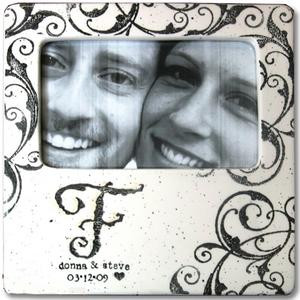 Hand painted ceramic photo frame personalized with single initials, first names, and dates