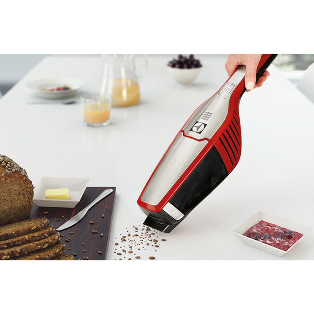 Battery operated hand vacuum cleans crumbs.