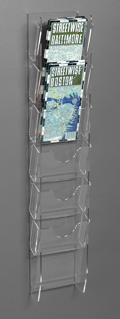 Clear acrylic wall ladder makes displaying maps, brochures, and other printed material easy and attractive.