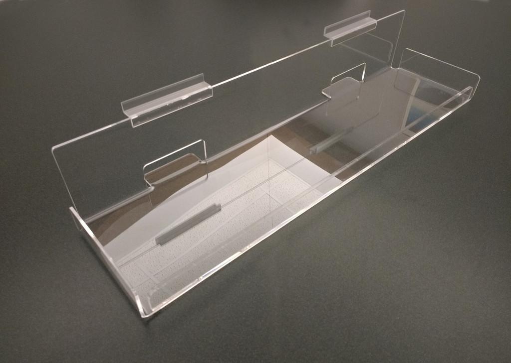 Journal shelf for slatwall.