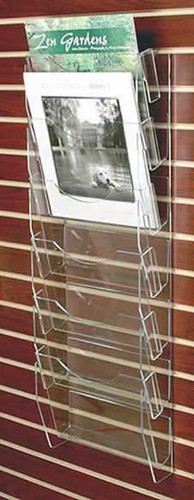 Clear acrylic slatwall mounted calendar rack with six pockets.