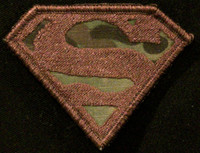 superman VELCRO® Brand morale patch subdued in multicam background