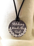 "Necklace Stitching Mends the Soul  1.75"" round on a 28"" satin cording Kelmscott Designsn"