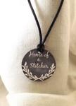 "Necklace Home of a Stitcher 1.75"" round on a 28"" satin cording Kelmscott Designs"