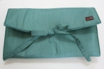 Denise in a Della Q Double Seafoam with Teal cords