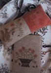 15-1338 Squirrel Pinkeep & Flower Basket THREAD BOARD Pinkeep: 81w x 62h, Thread Board: 75w x 66h Stacy Nash Primitives