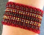 Stereo Cuff cerise (wool)  Nelkin Designs Knitting Kit