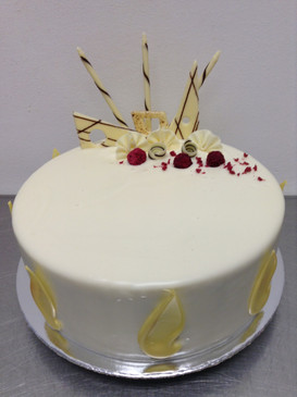 Elegant White Chocolate and Raspberry Mud Cake