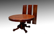 SOLD Round 54 inch split base Mahogany dining table
