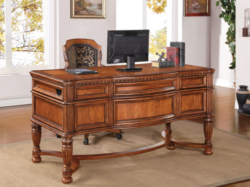 Writing Desk Understated elegance meets turn-of-the-century splendor.     Cordoba makes a statement thanks to its grand scale, solid pine wood construction, and sophisticated detailing. The ornate design features a reeded column that underscores the intricate elegance of the wood carving. Charming aged brass hardware completes the look, adding a touch of sophistication to any home office. A coordinating hutch can be added for additional storage.