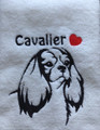 Cavalier (Fancy) on white towel with black thread