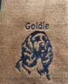 Cocker Spaniel (Fancy) on brown towel with black thread