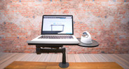 The UPLIFT Laptop Mount for Monitor Arms' rotating platform provides space for small item or mouse storage