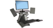 The HealthPostures TaskMate Executive 6100 Desk Converter moves from sit to stand position with electronic one-push button control