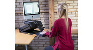 Benefits of an adjustable-height workstation include improved blood flow and increased productivity