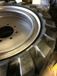 "12 16.5 NTJ Solid With No Holes on Rim 8on8"" BC 12x16.5 Skid Steer NTJ"