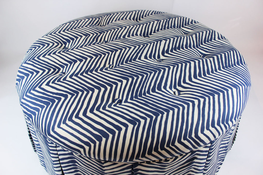 Top of Tufted Ottoman with fabric covered buttons.