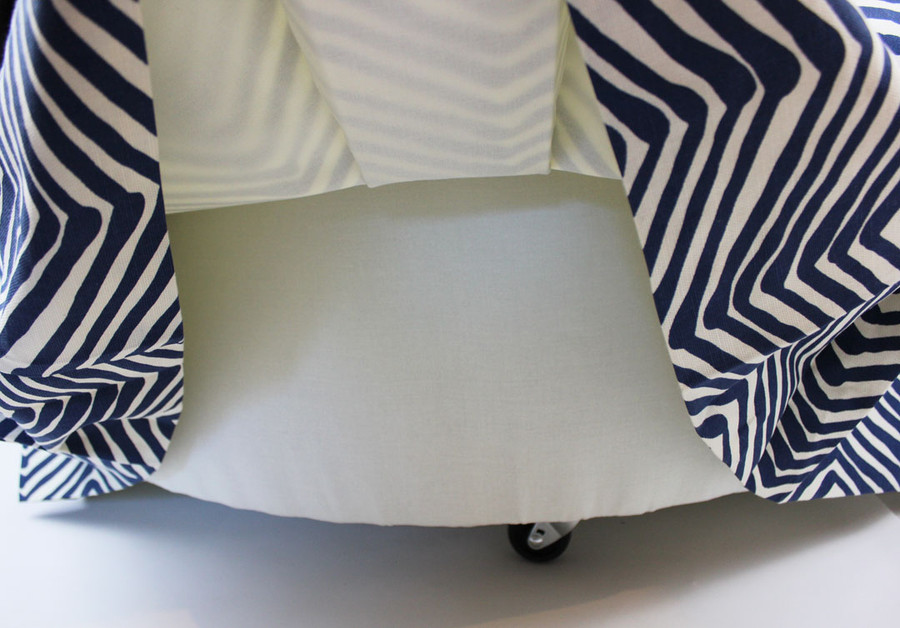 The underside of the ottoman is padded and covered in lining.  The ottoman skirt is lined.