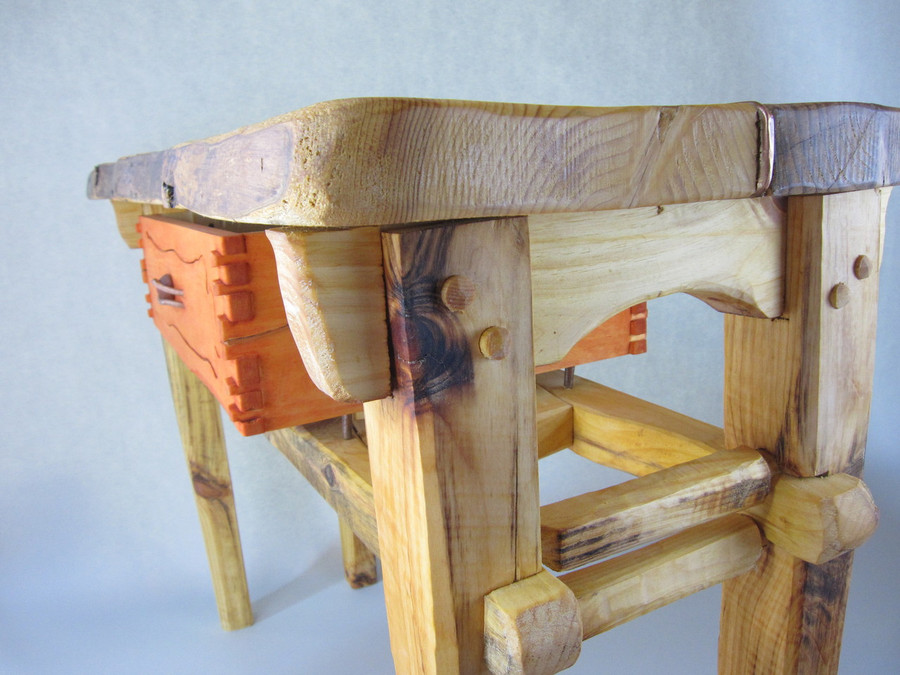 The table has beautiful joinery and detailing.