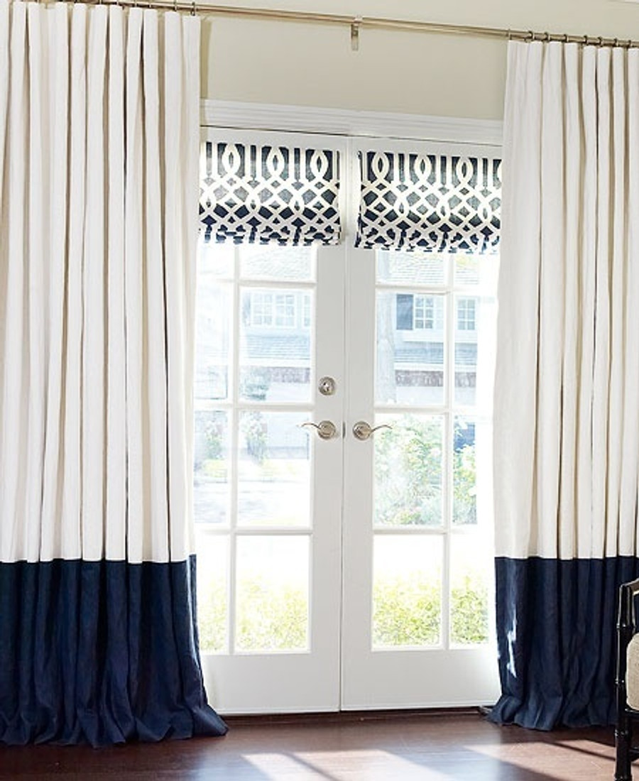 Beautiful Drapes with Contrast Dark Blue Border and Cartridge Pleats.  Roman Shades are Kelly Wearstler Imperial Trellis in Navy