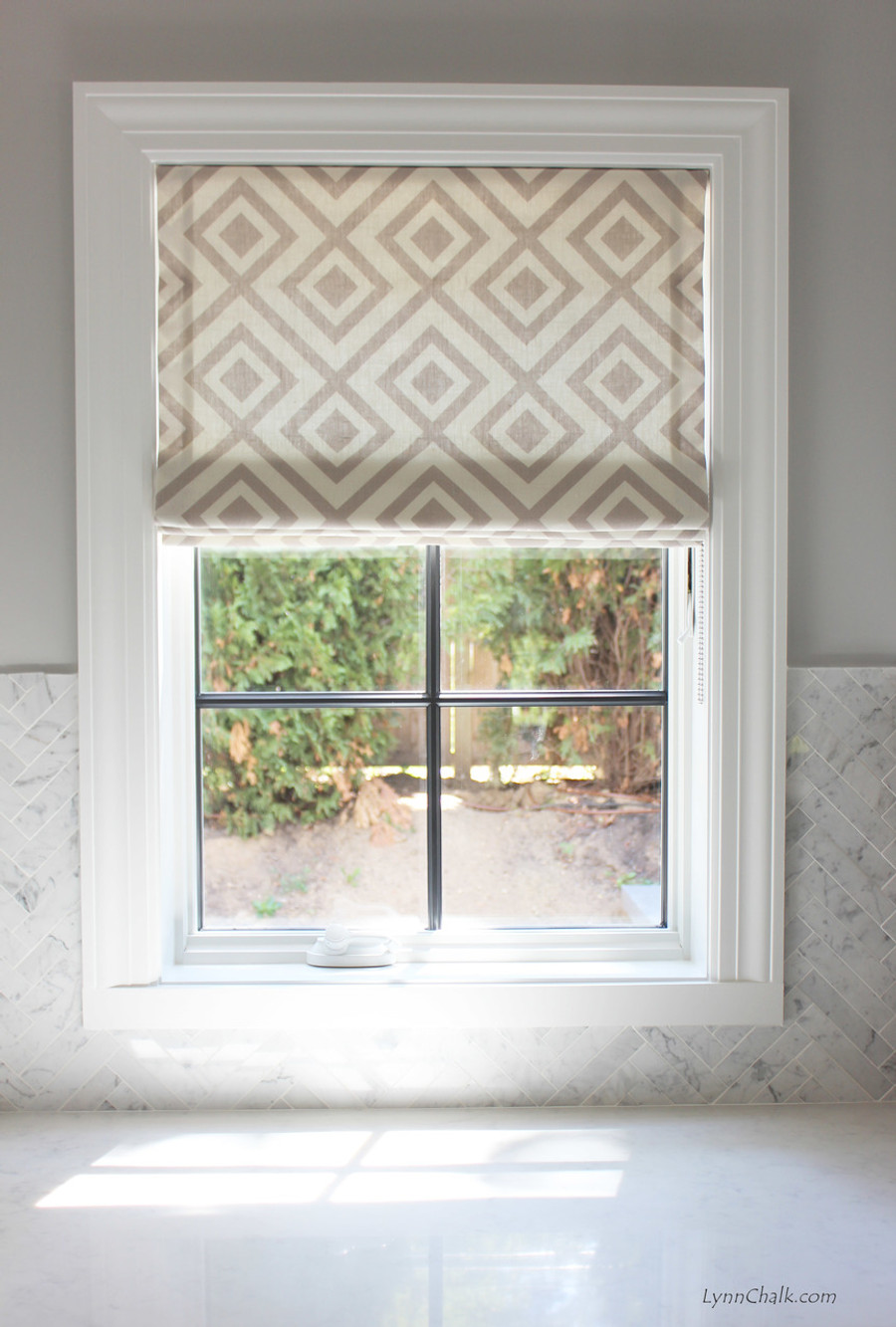 Roman Shade in La Fiorentina Lighter Grey with Off White Background.