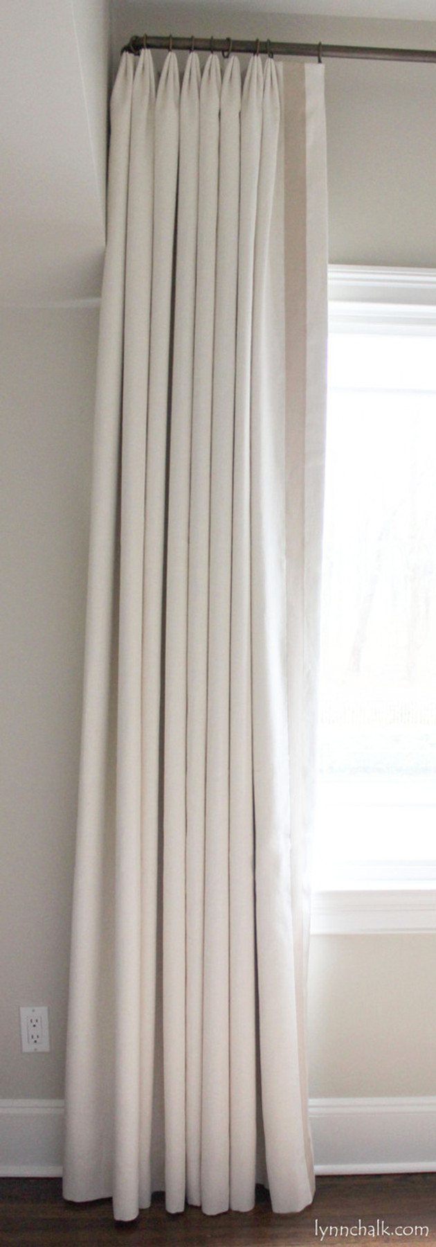 """Kravet Dublin Linen in Creme with 2"""" Wide Samuel & Sons Grosgrain Ribbon Trim in Sand set in 1 1/2"""" from edge.  Drapes are Double Width with Euro Pleat."""