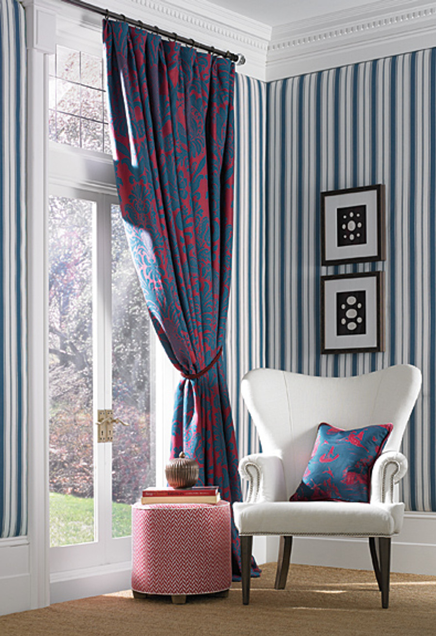 Anna Damask in Rouge/Prussian on Drapes and Coromandel in Prussian Blue/Rouge on Pillow.  Branca Stripe in Prussian Blue on Walls.