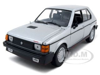 1985 Dodge Omni GLH Silver 1/24 Diecast Model Car Motormax 73342