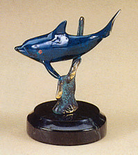 Pewter sculpture of Dolphin swimming by reef