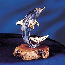 Glass dolphin on wood base