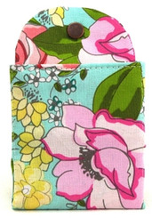 """Tea Wallet - to take your favorite tea to-go.  Holds six t-sacs pre-filled with loose tea or six tea bags.  High quality cotton fabric Made in New Hampshire Six slots for tea, plus four slots for sweeteners Your tea is held securely in the wallet with a strong snap Measures 3""""x 5"""" when folded closed The attractive and tidy replacement for that plastic zip-lock baggie in the bottom of your bag! EVERY tea lover needs one, every tea lover wants one!"""