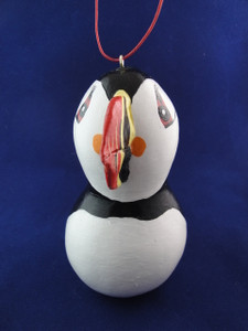 This is a lovely puffin ornament. It is also available in medium and large sizes.