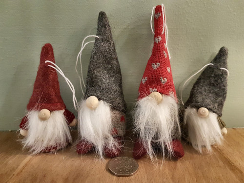 Tiny and small santa gnomes with red or grey hats