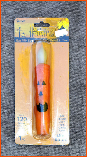 "Home for the Haunting 6.5"" Battery Operated Wax LED Taper Candle with Pumpkin Face"