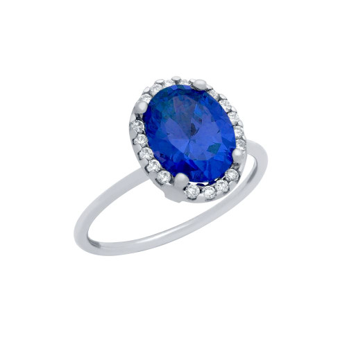 RHODIUM PLATED BLUE OVAL CZ RING WITH SURROUNDING CLEAR CZ STONES