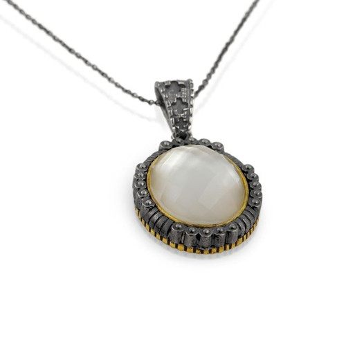 "SIGNATURE AUTHENTICO MOTHER OF PEARL FACETED OVAL PENDANT ON A 16"" NECKLACE"