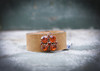 Vintage leather cuff with orange rhinestone on brown