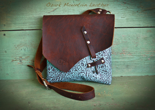 Bison and Turquoise Cross Body Leather Bag with skeleton key closure.