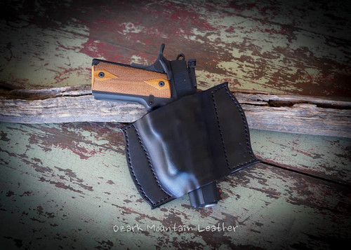 Custom leather gun holster for small to large frame guns.