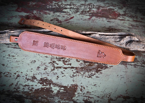 Custom leather rifle sling in brown.  Can be personalized with name or initials and also a custom stamp option.